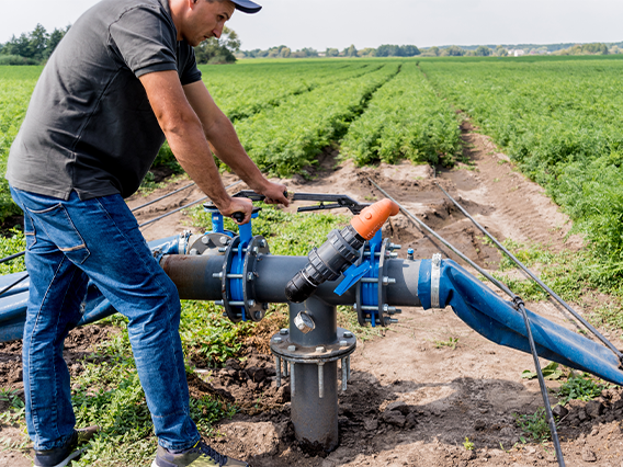 Adult male pumping groundwater for crops.