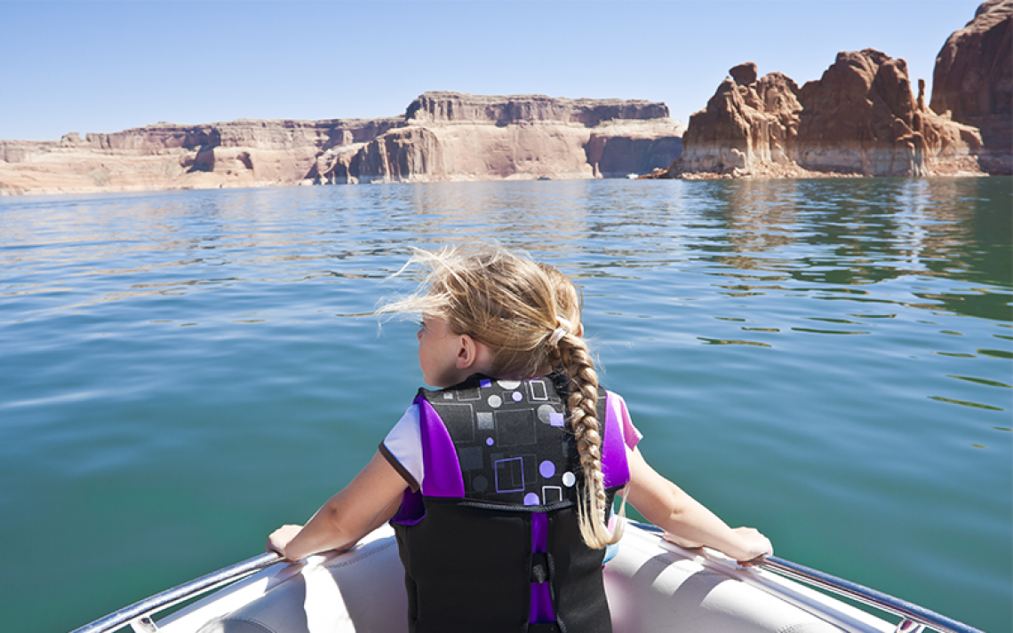 Water in AZ, little girl on a boat ride at Lake Powell.